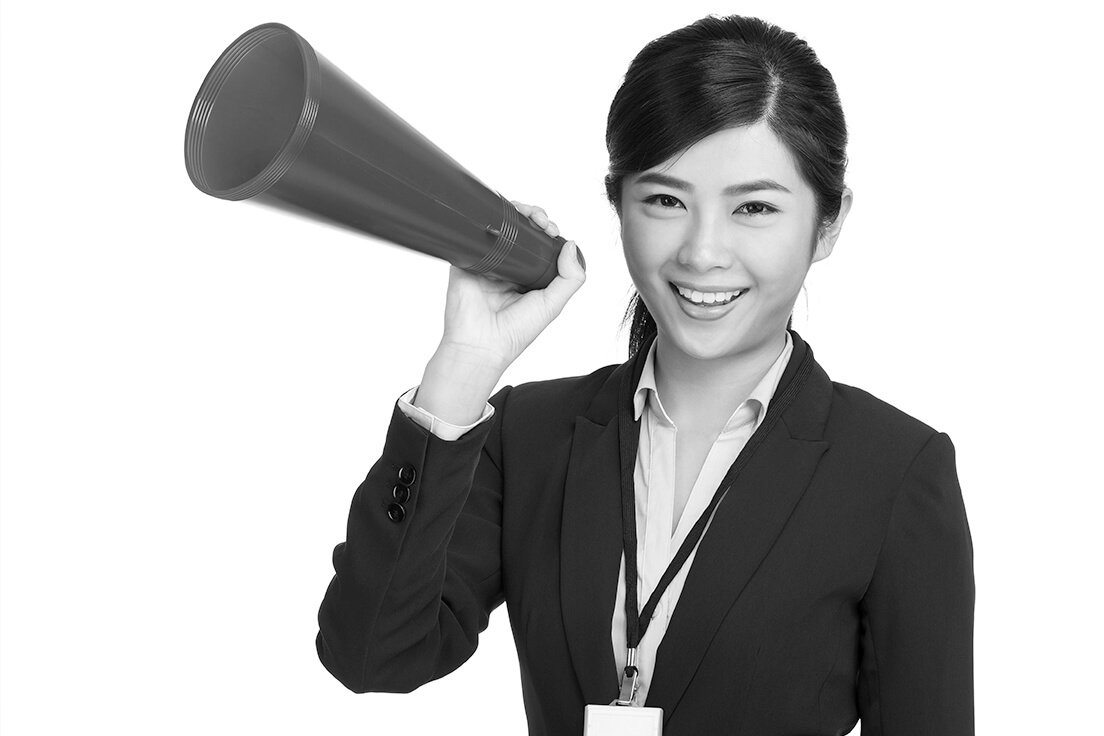 Business woman holding a megaphone